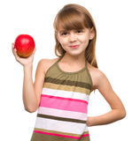 Little girl with red apple Royalty Free Stock Image