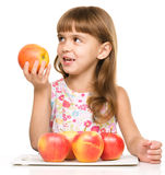 Little girl with red apples Royalty Free Stock Photography