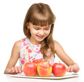Little girl with red apples Royalty Free Stock Image