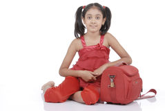 Little girl with red bag Royalty Free Stock Photos