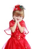 Little girl in a red ball gown. Stock Photos