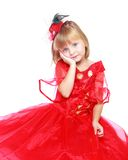 Little girl in a red ball gown. Royalty Free Stock Photo