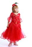 Little girl in a red ball gown. Royalty Free Stock Image