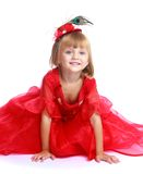 Little girl in a red ball gown. Royalty Free Stock Photography