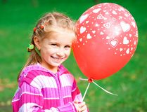 Little girl with red balloon Stock Photo