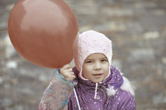 Little girl with red balloon Royalty Free Stock Images