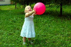 Little girl with red balloon in the forest. Royalty Free Stock Images