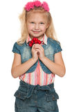 Little girl with red berries Royalty Free Stock Photography