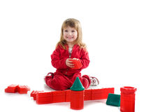 Little girl with red blocks Royalty Free Stock Photo