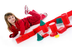 Little girl with red blocks Royalty Free Stock Image