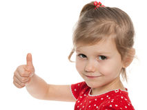 Little girl in red blouse holds her thumb up Royalty Free Stock Photos