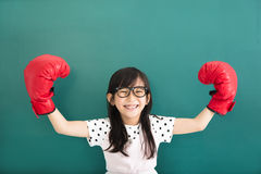 Little girl with red boxing gloves before chalkboard Stock Images