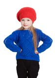 Little girl in a red cap smiles. Little girl in a red cap with hands on hips isolated on white Royalty Free Stock Images