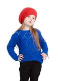 Little girl in a red cap smiles. Little girl in a red cap with hands on hips isolated on white Royalty Free Stock Photography