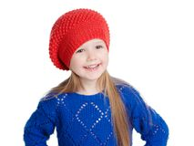 Little girl in a red cap smiles. Isolation on white Royalty Free Stock Photos