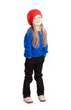 Little girl in a red cap smiles. Isolation on white Stock Images