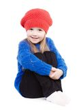 Little girl in a red cap smiles. Isolation on white Royalty Free Stock Photography