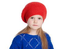 Little girl in a red cap smiles Royalty Free Stock Photos