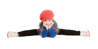 Little girl in a red cap smiles. Little girl in a red cap sat on the twine Stock Photos