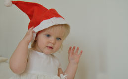 Little girl with a red Christmas hat Stock Image