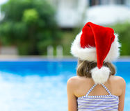 Little girl in red christmas hat. Royalty Free Stock Photos
