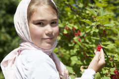 Little girl with red currant Royalty Free Stock Image
