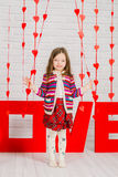Little girl with red decoration for Valentines Day Stock Photography