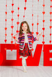 Little girl with red decoration for Valentines Day Royalty Free Stock Photos