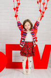 Little girl with red decoration for Valentines Day Stock Image