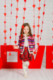 Little girl with red decoration for Valentines Day Royalty Free Stock Photo
