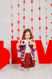 Little girl with red decoration for Valentines Day Stock Photo