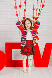 Little girl with red decoration for Valentines Day Royalty Free Stock Image