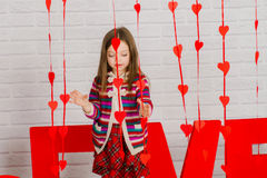 Little girl with red decoration for Valentines Day Royalty Free Stock Photography
