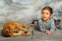Little girl with a red dog. Little girl and her friend the dog Stock Photography