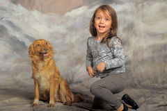 Little girl with a red dog. Little girl and her friend the dog Stock Photos