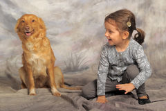 Little girl with a red dog. Little girl and her friend the dog Royalty Free Stock Images