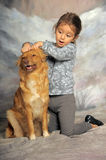 Little girl with a red dog. Little girl and her friend the dog Stock Image