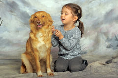 Little girl with a red dog. Little girl and her friend the dog Stock Images