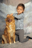 Little girl with a red dog. Little girl and her friend the dog Royalty Free Stock Photos