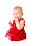 Little girl in red dress Stock Image