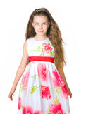 Little girl in red dress. On white background Royalty Free Stock Images