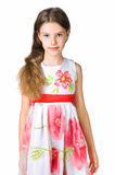 Little girl in red dress. On white background Stock Image