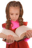 Little girl in red dress and with book Royalty Free Stock Image