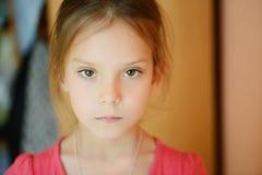 Little girl in red dress. Little calm girl in red dress Stock Image