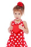 Little girl in red dress. Cuddle box in the form of heart.Isolated on white background Stock Photo