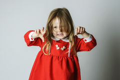 Little girl in red dress frighten photographer Royalty Free Stock Photos