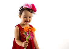 Little girl in red dress with a gerbera bouquet in her hand isolated Royalty Free Stock Images