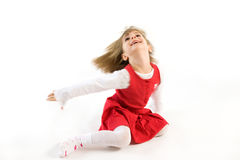 Little girl in a red dress having fun Stock Photos