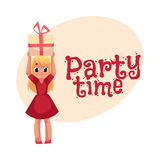 Little girl in red dress holding birthday gift over head Stock Photos