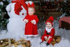 Little girl in red dress at a home interior waiting for Santa. stock photos